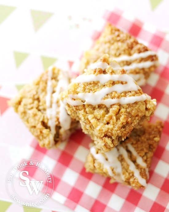Golden Lemon and Ginger Flapjacks with a white drizzle icing on a check napkin for the Royal Wedding