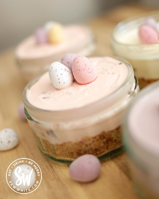 pastel pink cheesecake for Easter studded with mini eggs.
