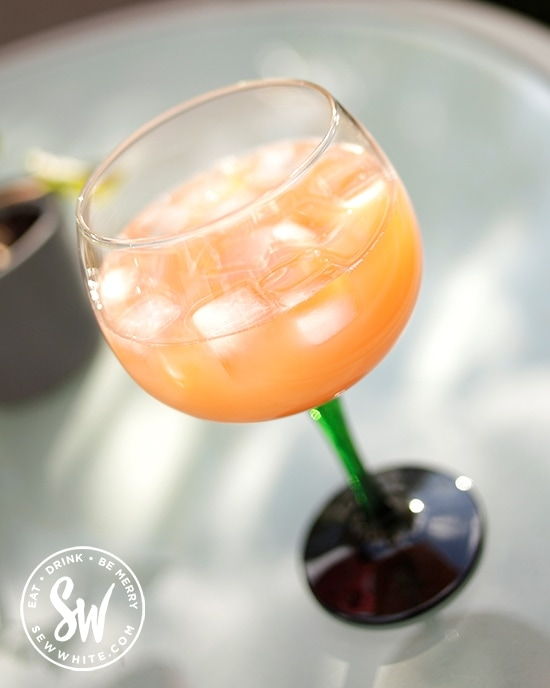 orange cocktail made with Aperol and apple juice