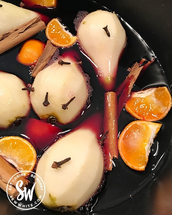 Mulled Wine Pears with oranges and spices in a slow cooker