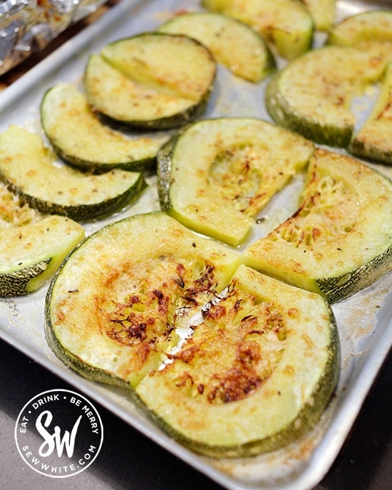 Golden brown roasted cheesey round courgettes