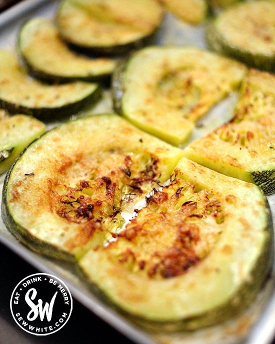 Golden brown Roasted Parmesan Courgettes on a baking tray