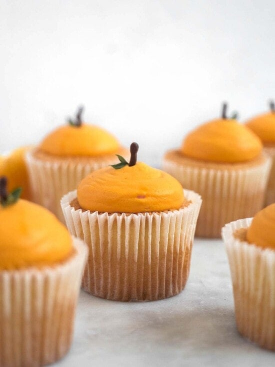 Mandarin shaped cotton-soft chiffon cupcakes with citrus whipped cream