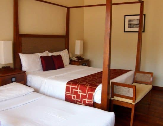Bedroom at Eden Resort and Spa with extra child bed.