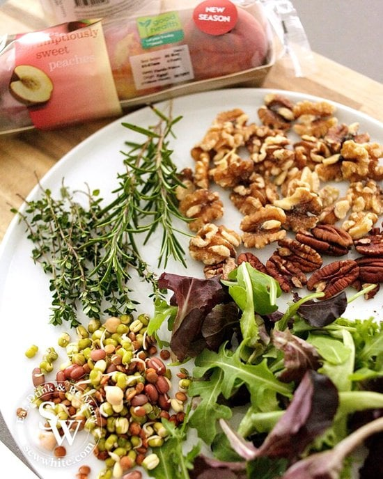 The raw ingredients for making the Maple Syrup Grilled Peach and Nut Salad. Including lentils, herbs and nuts.
