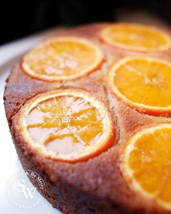 Glistening drizzle over the freshly baked Orange Upside Down Cake orange sponge.