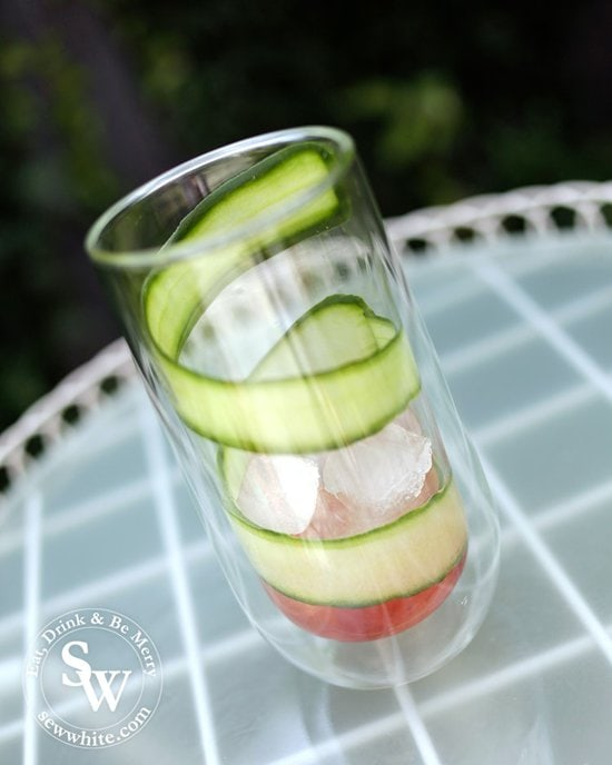 Freshly sliced cucumber strip rapped around the glass for the punch.