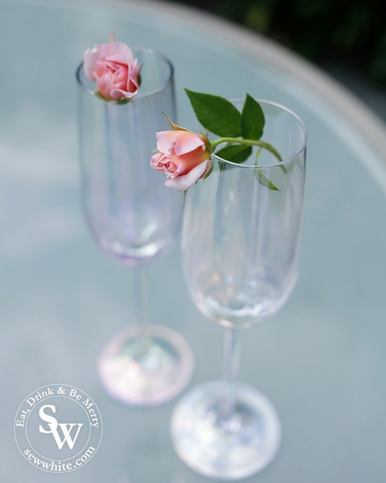 delicate roses balanced on champagne glasses for the prosecco cocktail with rose and elderflower