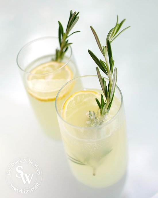 Ready to serve rosemary lemonade garnished with rosemary and a lemon slice.