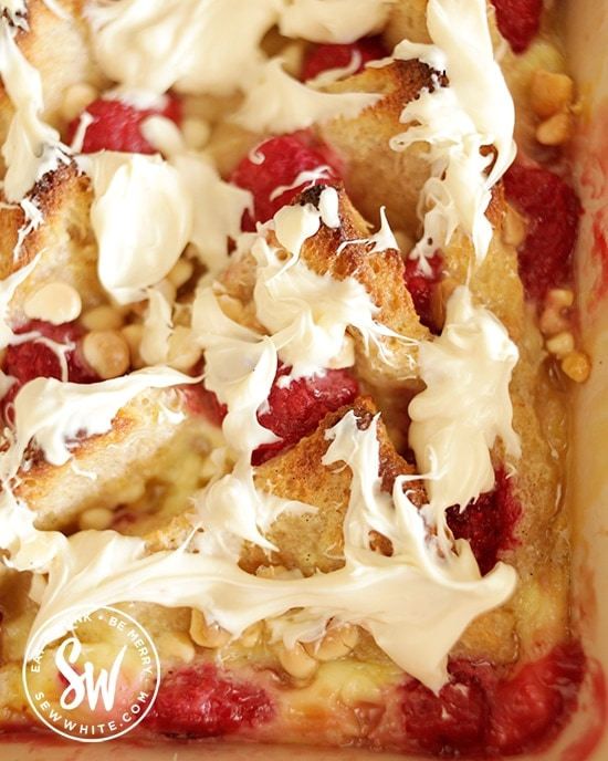 white chocolate drizzled over the golden baked Raspberry Bread and Butter Pudding