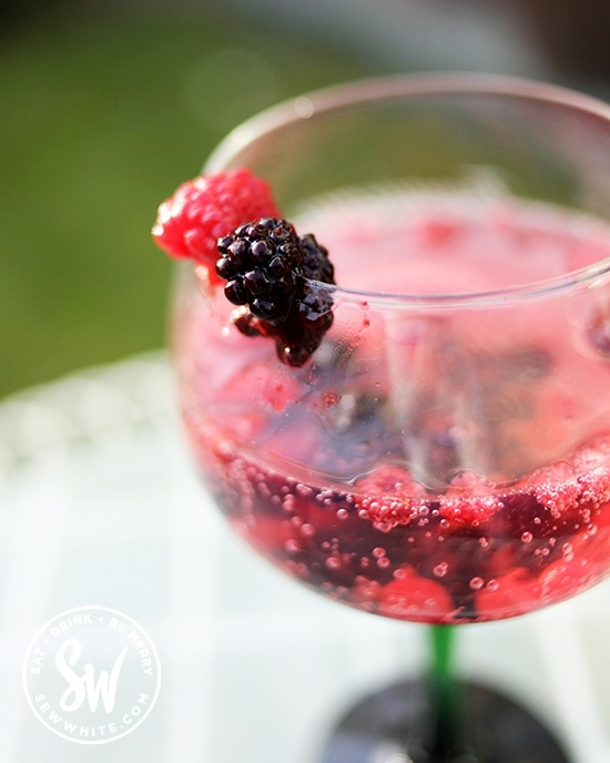summer berries cocktail made with frozen fruit.