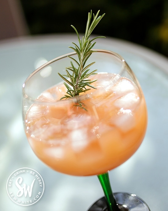 Aperol apple cocktail in the easy cocktail recipes decorated with fresh rosemary