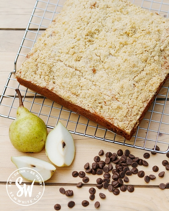 baking with fresh pears, a golden brown baked pear crumble cake made with chocolate chips