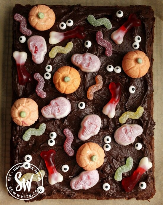 Easy Halloween Chocolate Cake covered with Halloween candy and sweets and eye sprinkles