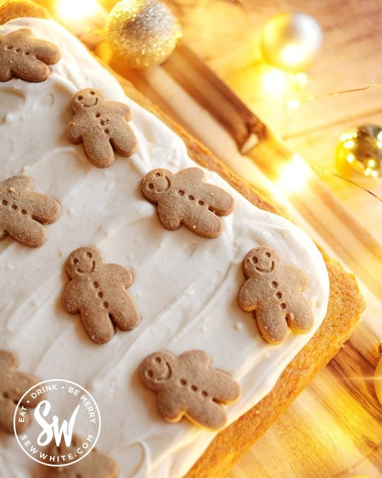 Smiling gingerbread men on a ginger traybake cake
