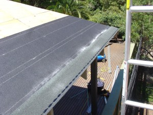 Completed line of asphalt roof shingle starter course