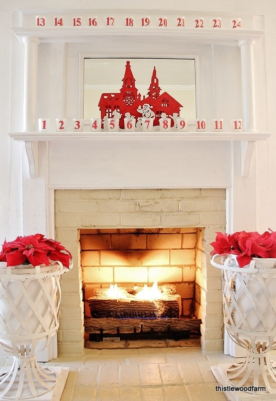 This Christmas mantel with numbered candles adds holiday cheer to the living room.