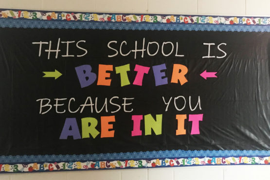 "Green Chimneys School bulletin board displays the message, ""This school is better because you are in it."""
