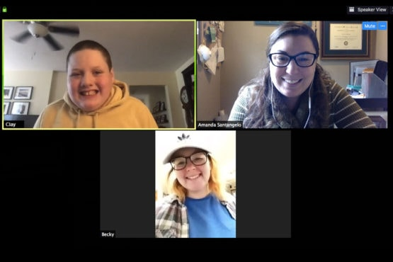 Image of student, speech-language pathologist, and intern connecting via zoom.