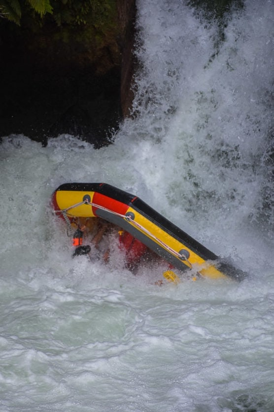 flipping over tutea falls on new zealand rafting trip with kaituna cascades