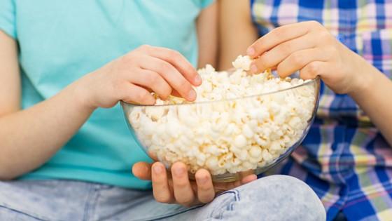 Holding Bowl of Popcorn