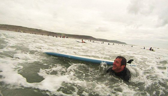 Simon trying to surf!