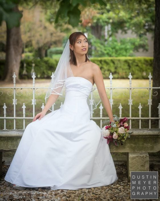 a bridal portrait from a wedding photography workshop outdoors in a wedding dress and holding a bouquet