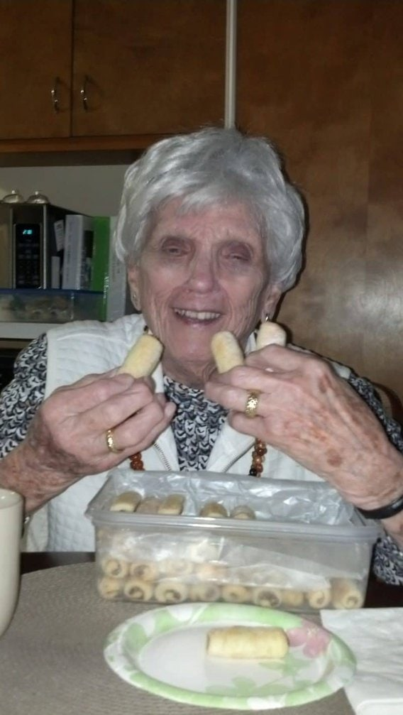 Annie Roy - Thanksgiving 2016 -Roczki Cookies (Kolacky) are made with a tender, yeasted dough rolled up in a cigar shape with a simple, lemony, ground nut filling. www.savingdessert.com
