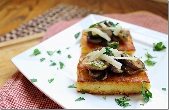 Pan fried polenta cakes are crispy and delicious topped with a simple mushroom ragu.