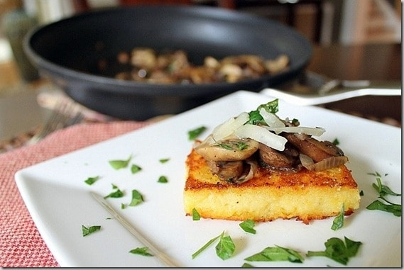 These crispy polenta cakes are topped with a simple mushroom ragu. Elegant, delicious and easy, they're the perfect party appetizer.