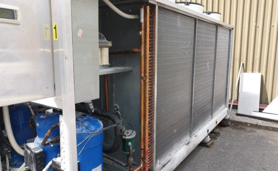 Chilled water system repair of condenser to a silver chiller with blue compressors