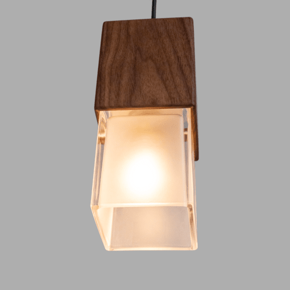prairie pendant light, lit up, thick glass and walnut wood