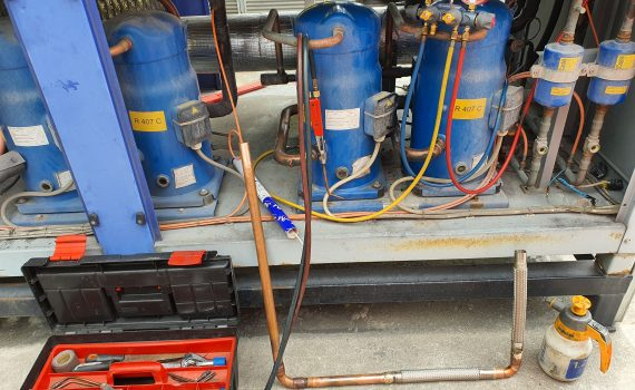 Brazing equipment box and vibration eliminators during packaged chiller service