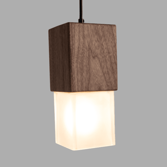 prairie wood and glass pendant light lit showing isometric view