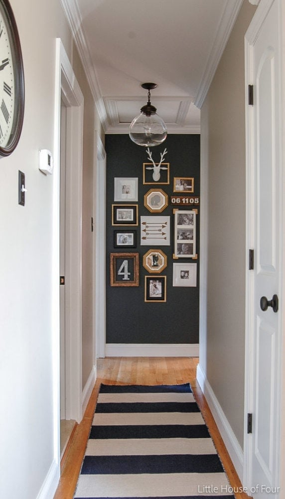 hallway with family photo gallery wall