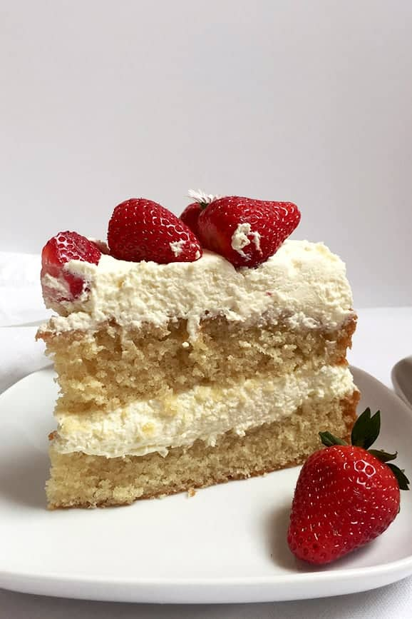 A Slice of Strawberry Layer Cake Filled with Whipped Cream