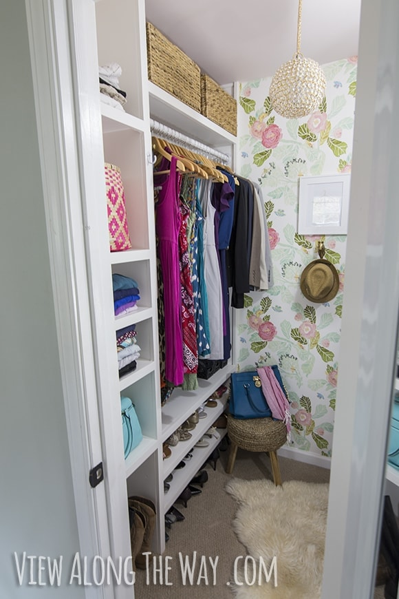 closet with wallpaper and DIY organization