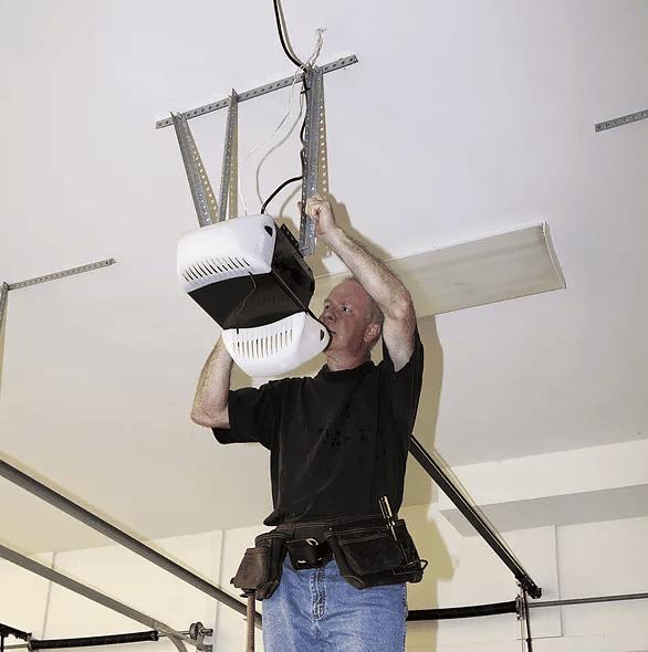 Garage Door opener repair man repairing a garage door opener