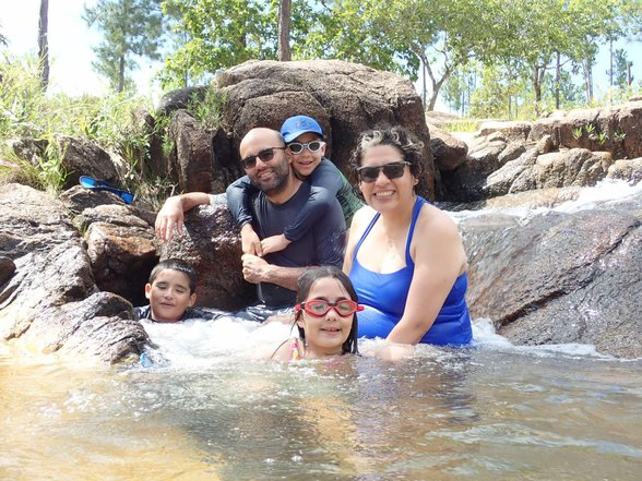 Joe From TO Mateo Daniela Marco and Charo sitting in a natural pool surrounded by rocks