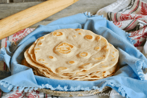 A plate of warm homemade sourdough tortillas just waiting for your favorite toppings.