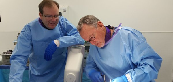 Dr. Bergin (left) and Dr. Bernstein (right) collaborate on a procedure.