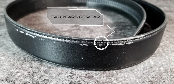 Kore Essentials leather EDC belt close up of two years of wear