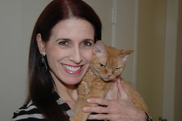 Debbie with her beloved cat Coco | 40plusstyle.com