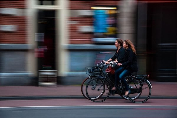 Two women on relaxed cruiser bikes