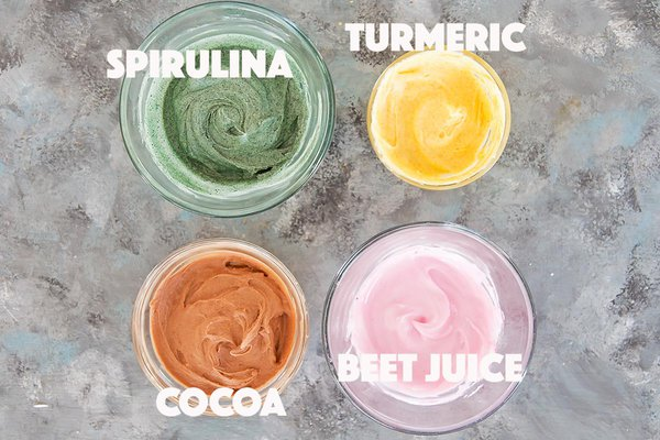 Naturally dyed royal icing, spirulina for green, turmeric for yellow, cocoa for brown, beet juice for pink