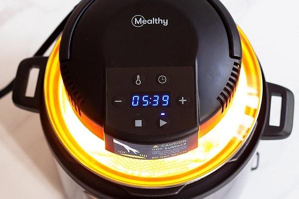 Mealthy CrispLid Air Frying on top of pressure cooker