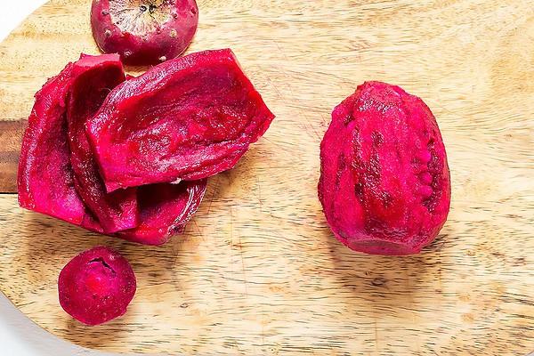 Peel and flesh of desert pear on cutting board