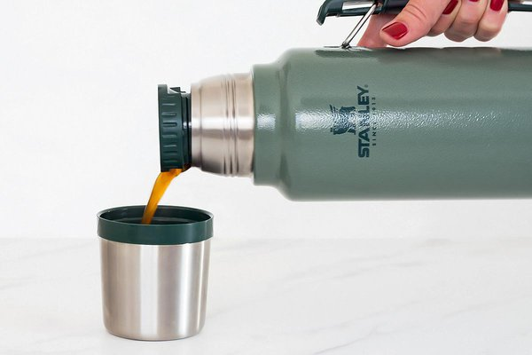 Pouring coffee out of Stanley Classic Vacuum Bottle into mug