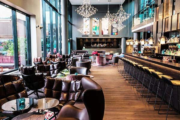 Grab your favorite drink at Motel One Wein Westbahnhof's bar