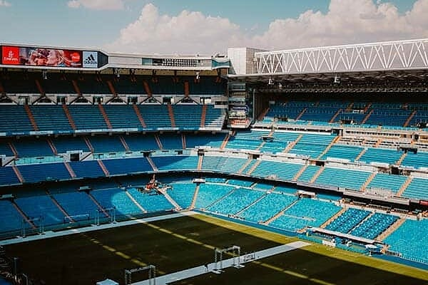 Catch an exciting football game in Santiago Bernabeu Stadium